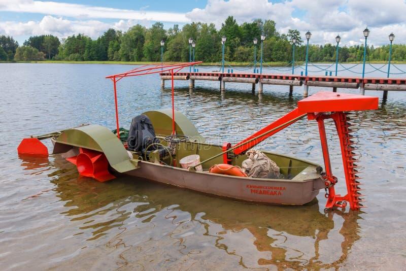 收获的藤茎小船收割机 图库摄影