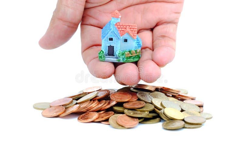 收集购买的硬币房子概念 库存照片