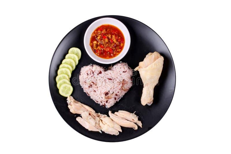 放出的红褐色的油腻的米和放出的鸡 库存图片