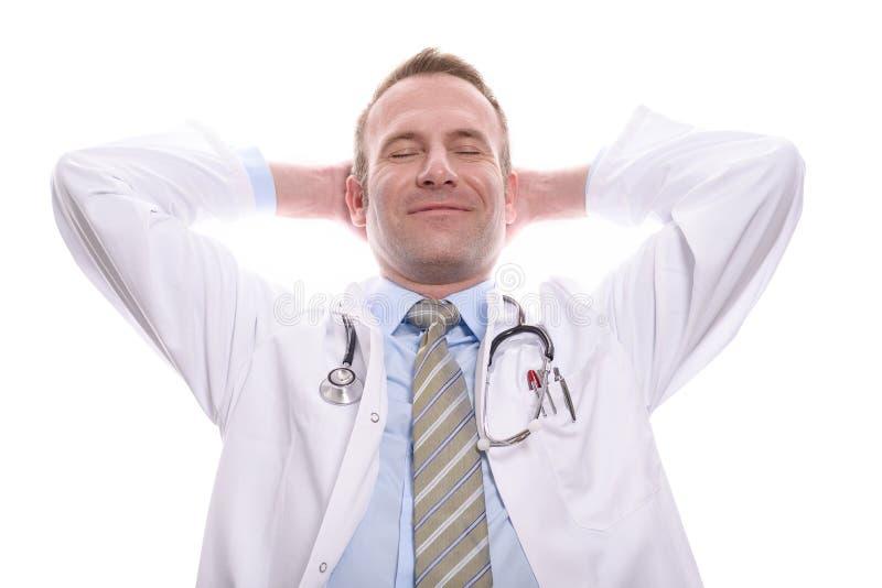 放松与微笑的满意的成功的医生 库存照片