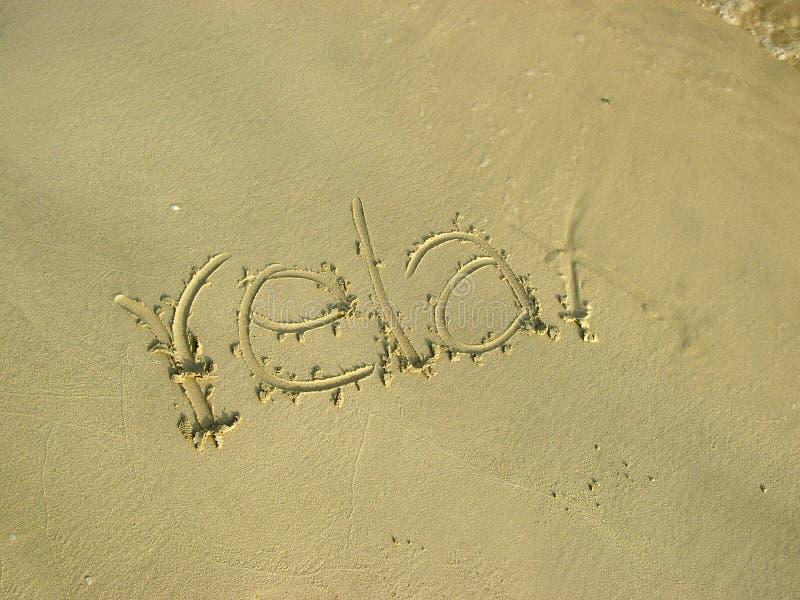 放松在海滩沙子 库存照片