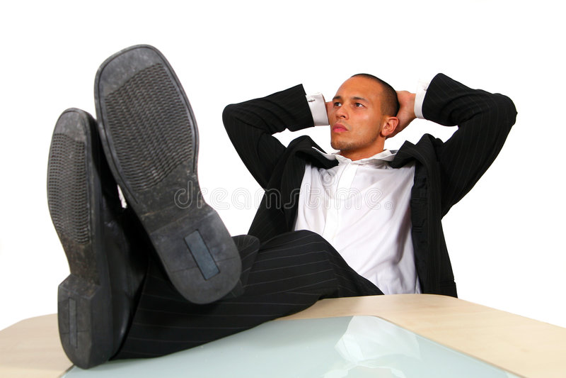 放松的生意人办公室 库存照片