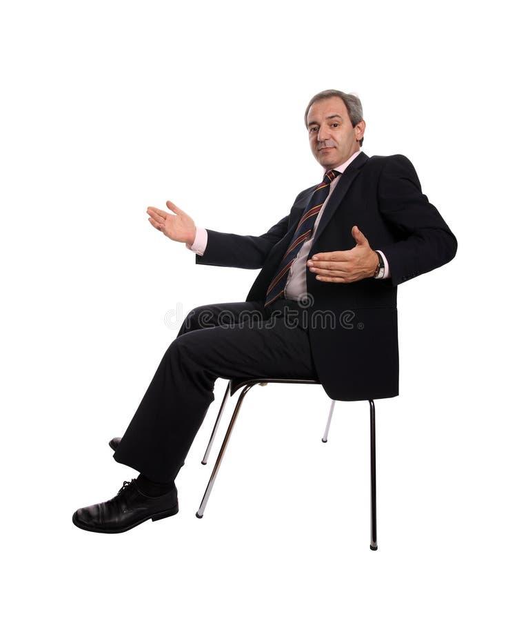 放松的生意人椅子安装了 库存照片