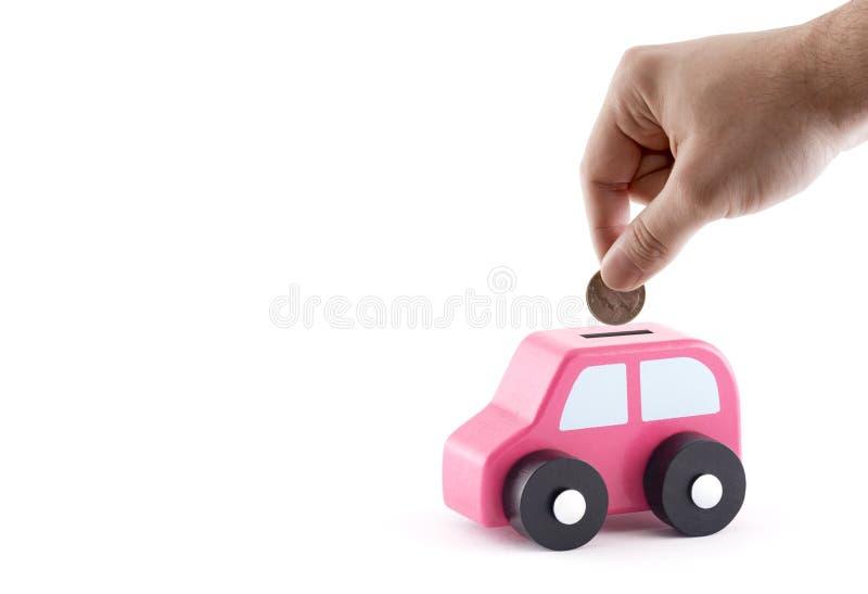 放硬币入汽车硬币银行 库存图片