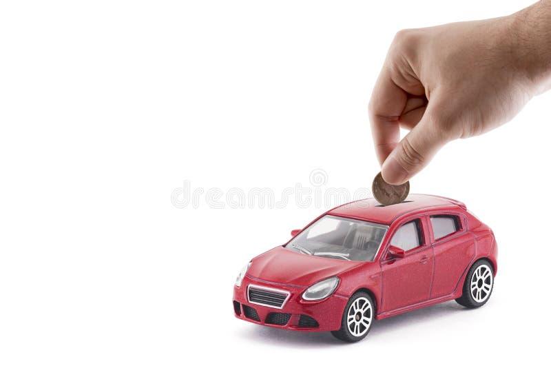 放硬币入汽车硬币银行 库存照片