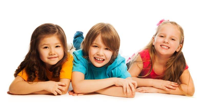放置在线的三个孩子 库存照片