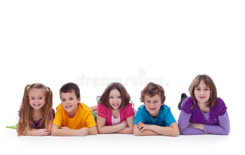 放置年轻人的楼层孩子 免版税库存照片