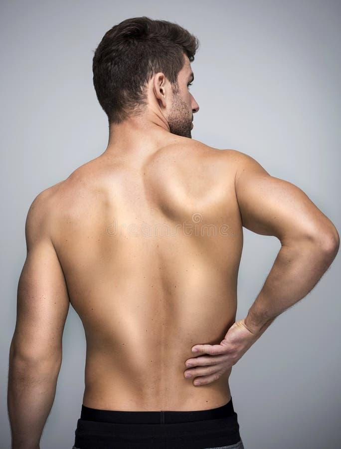 放置男性人肌肉脖子痛部分地严重肩膀疼痛的酸疼的回到河床成为不饱和的体验的图象伤害拉紧了 库存图片