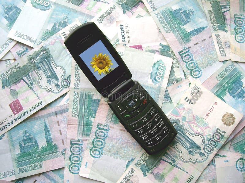 放置移动电话俄国的钞票 库存照片