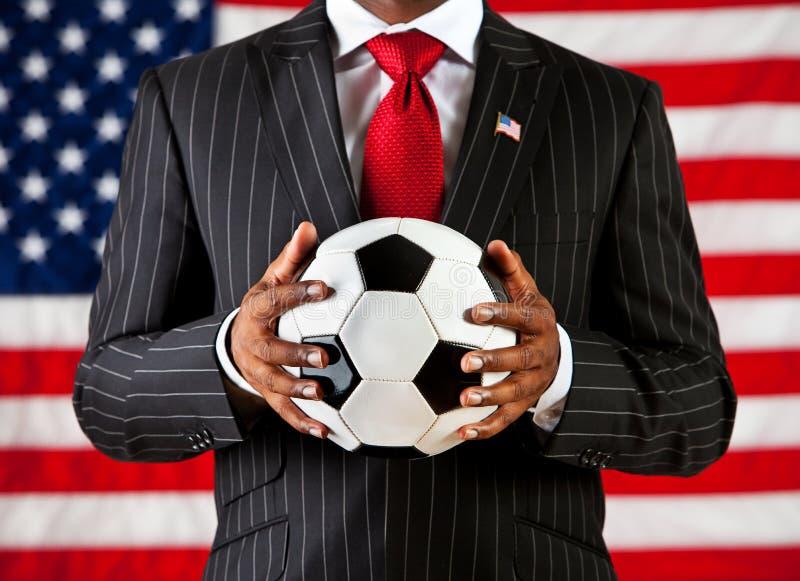 政客:拿着足球 免版税库存照片