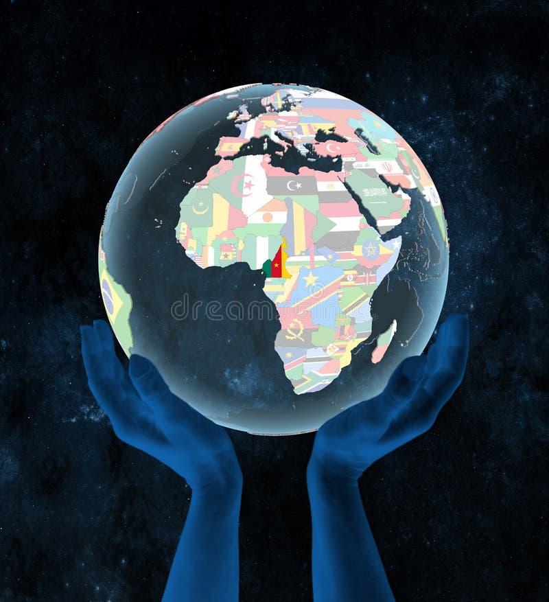 政治地球的喀麦隆在手上 皇族释放例证