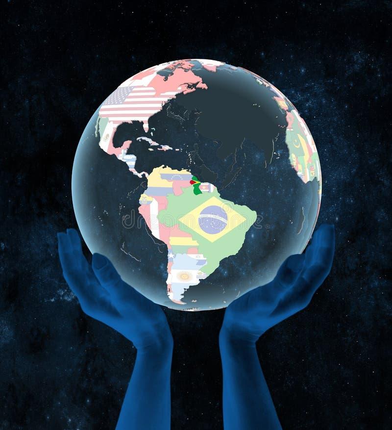 政治地球的圭亚那在手上 皇族释放例证