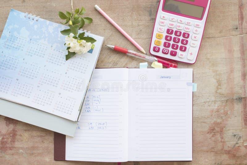 财政的笔记本月度计划者纪录 库存照片