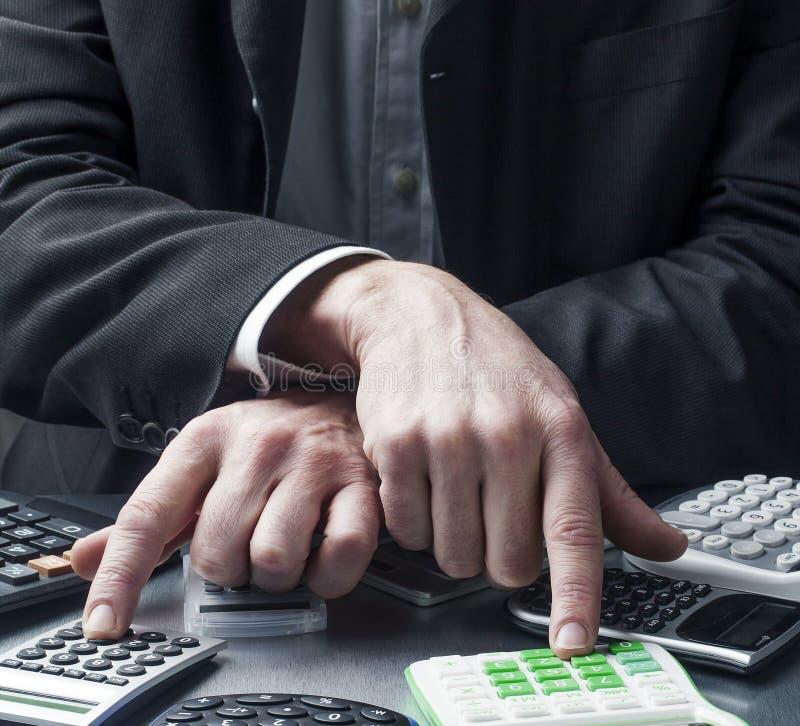 财政经理控制费用在工作 库存图片