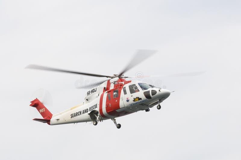 查寻和抢救SAR直升机 图库摄影