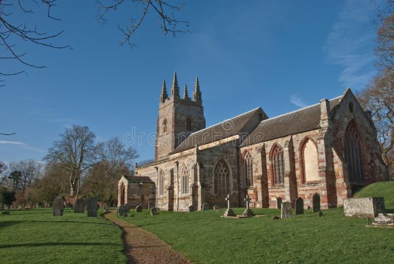 教会英国村庄冬天 库存图片