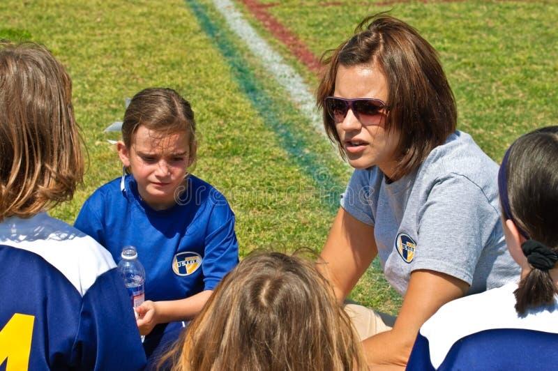 教练女孩足球妇女 免版税库存照片