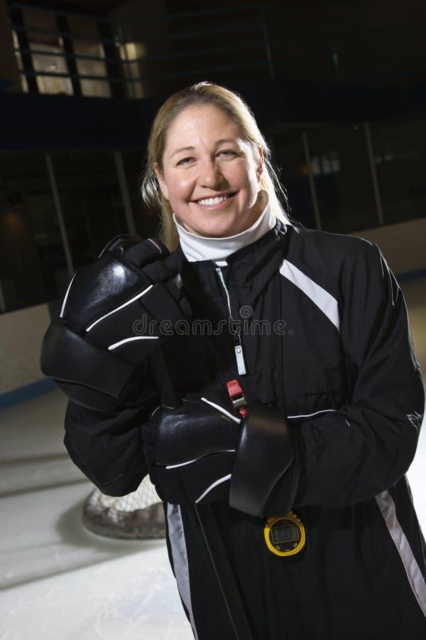 教练女性曲棍球 免版税图库摄影