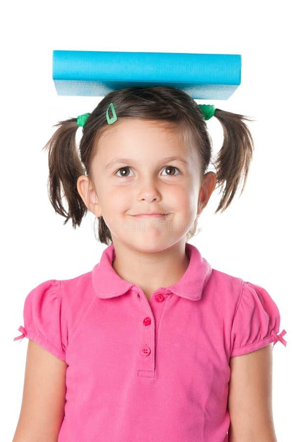 教育女孩满足的一点 免版税图库摄影