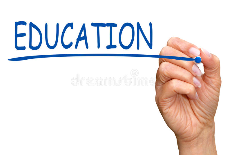 教育-有蓝色标志文字文本的女性手 库存图片