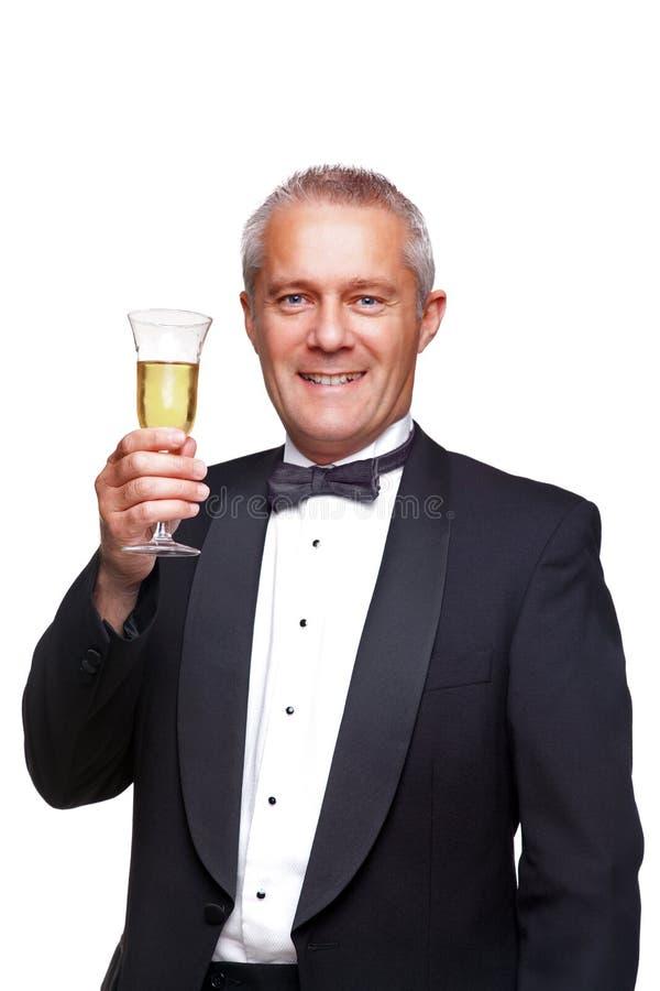敬酒无尾礼服的香槟人 免版税库存照片