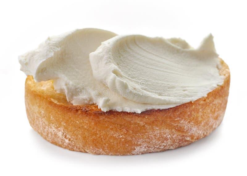 敬酒的面包用乳脂干酪 库存图片