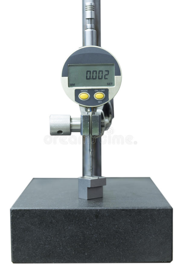数字式拨号盘在花岗岩桌孤立的测量仪测量 库存照片