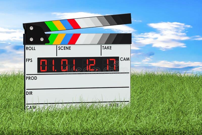 数字式电影在绿草的拍板反对蓝天, 库存例证