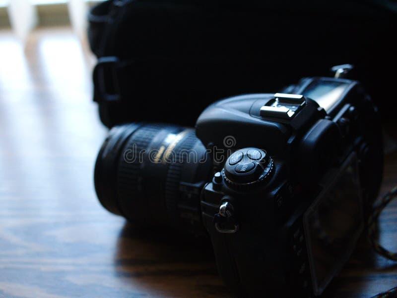 数字照相机拨号盘和瘤坐书桌 免版税库存照片
