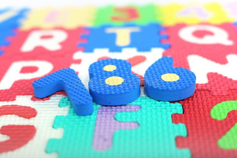 数字的图片在色的字母表信件的 免版税库存图片