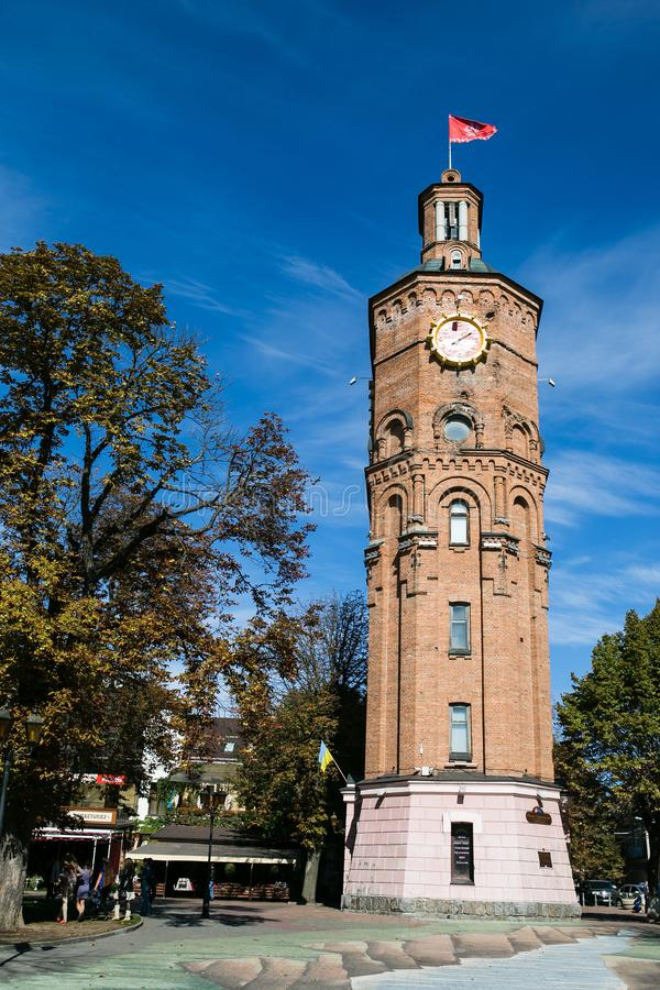 文尼察,乌克兰- 2015年10月03日:与时钟,文尼察,乌克兰的老了望塔 图库摄影