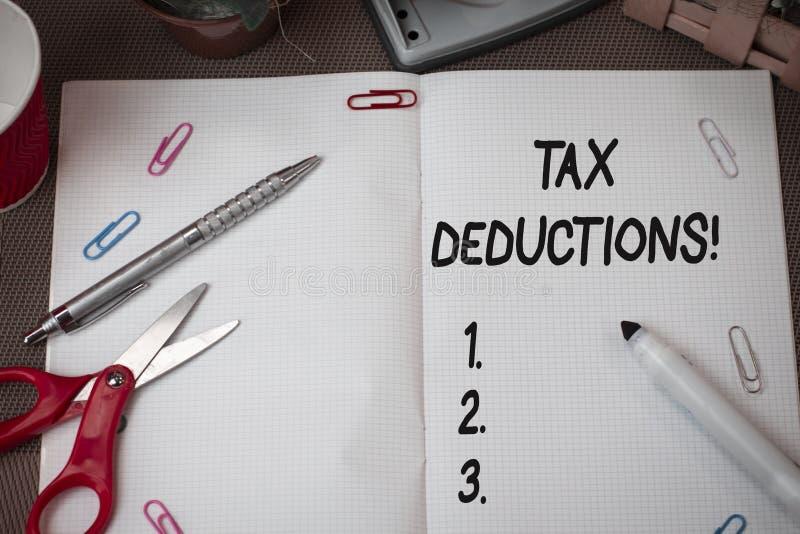 文本标志陈列税收减免 能被收税费用剪刀和的概念性照片减少收入 库存图片