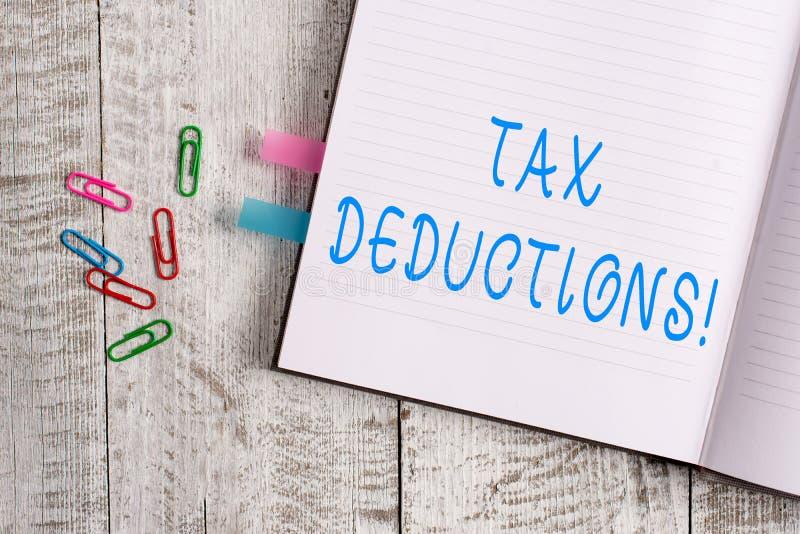文本标志陈列税收减免 能被收税费用厚实的页的概念性照片减少收入 库存照片