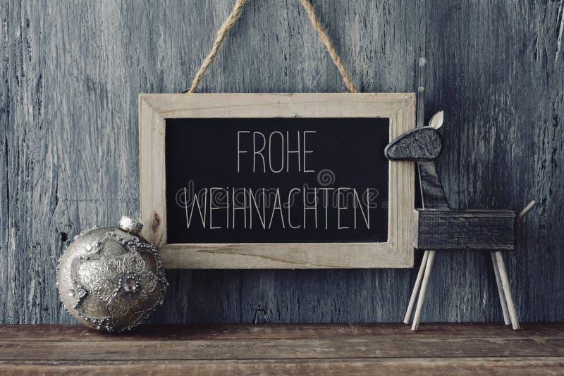 文本Frohe Weihnachten,圣诞快乐用德语 免版税图库摄影