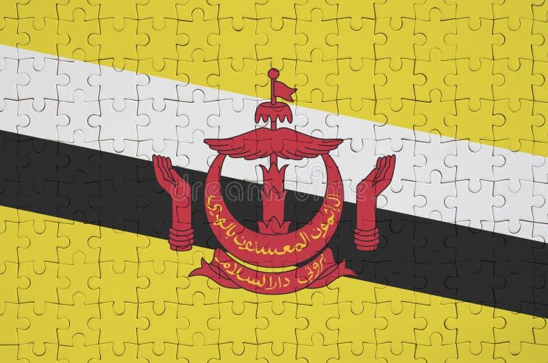 文莱达鲁萨兰旗子在一个被折叠的难题被描述 皇族释放例证