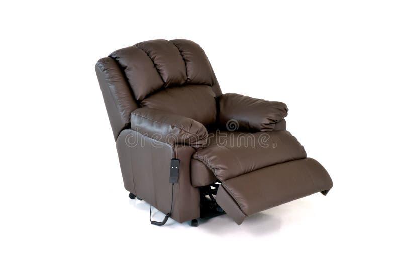 斜倚的皮椅 免版税库存图片