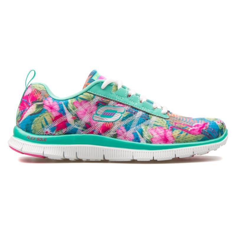 斯凯奇导电线呼吁花卉绽放水色运动鞋 库存照片
