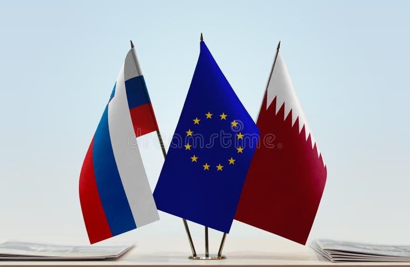 斯洛文尼亚欧盟和卡塔尔的旗子 库存图片