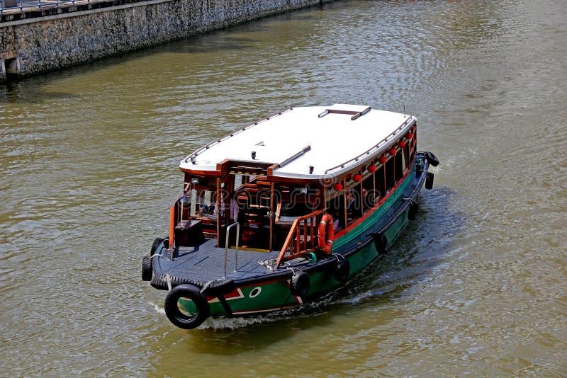 新加坡河小船 库存照片