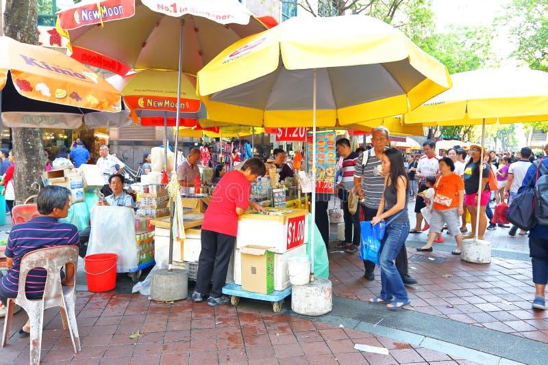 新加坡:滑铁卢街道的Steet供营商 免版税库存图片
