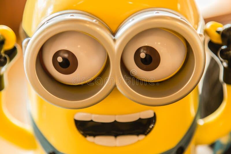 新加坡10 2017年9月:黄色颜色奴才形象玩具面孔特写镜头视图 库存照片