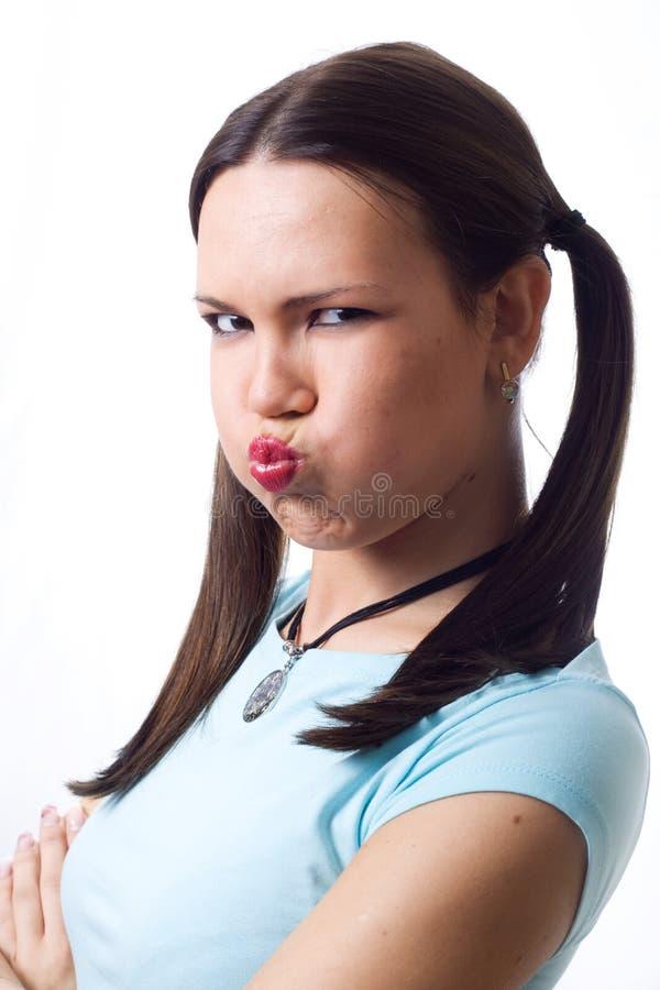 新吹的面颊的女孩 库存图片