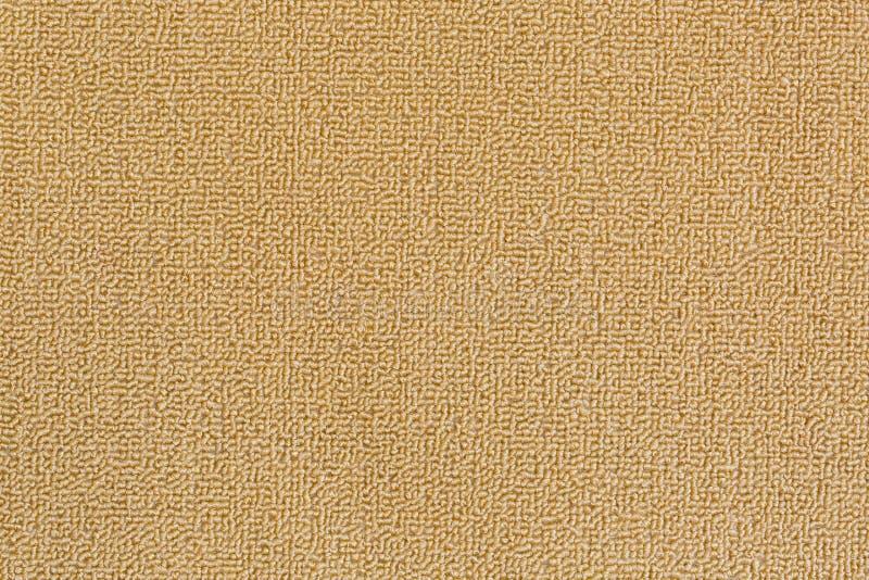 新和干净的地板地毯,在米黄co的擦鞋垫详细的纹理  库存照片