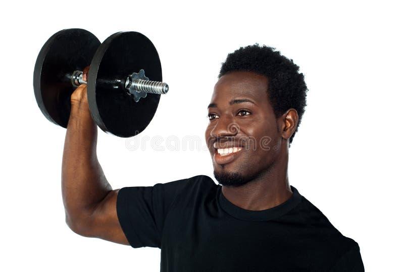 新增强的人肌肉强大的重量 免版税库存图片