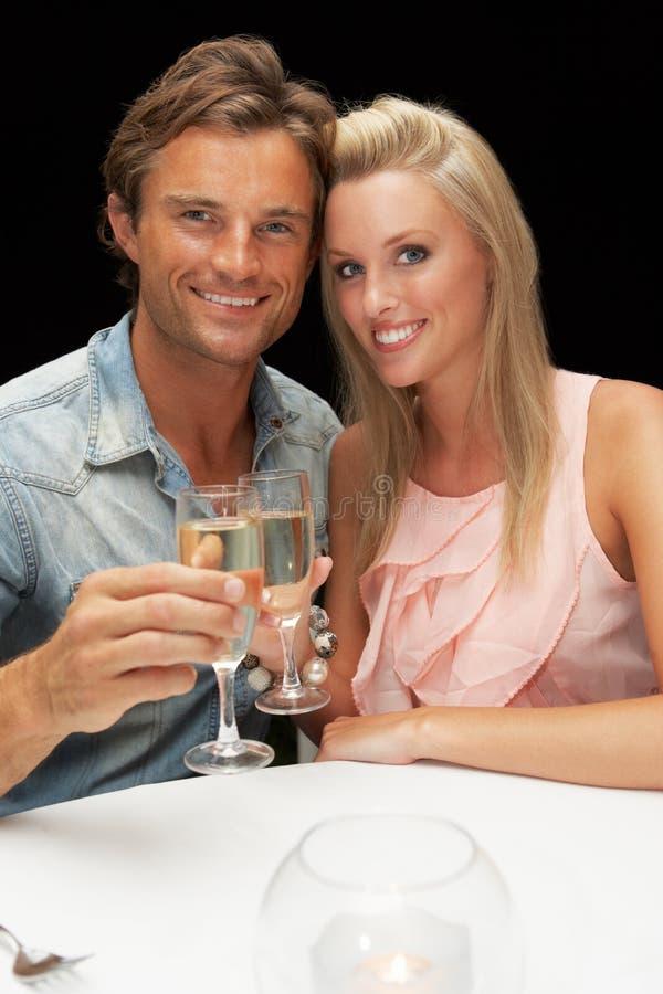 新夫妇在餐馆 图库摄影