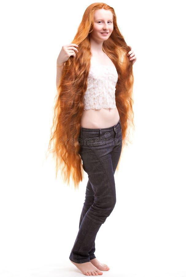 新头发长的红色的妇女 库存图片