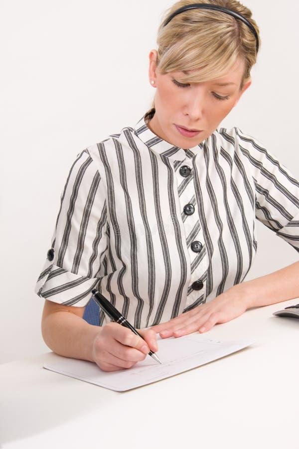 新女实业家在工作 免版税库存照片