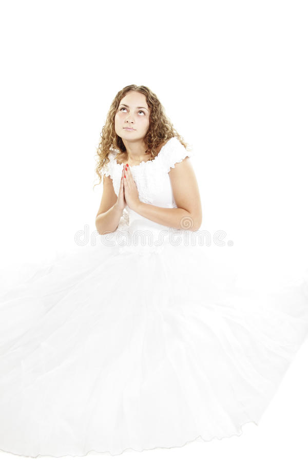 新娘卷曲祈祷 免版税库存照片