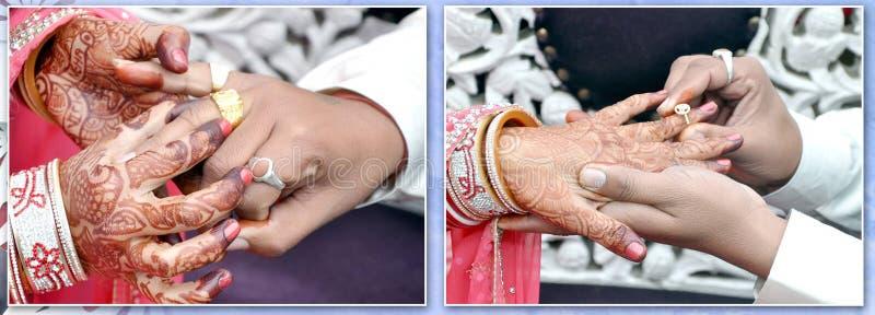 新娘和新郎交换婚戒 免版税库存图片