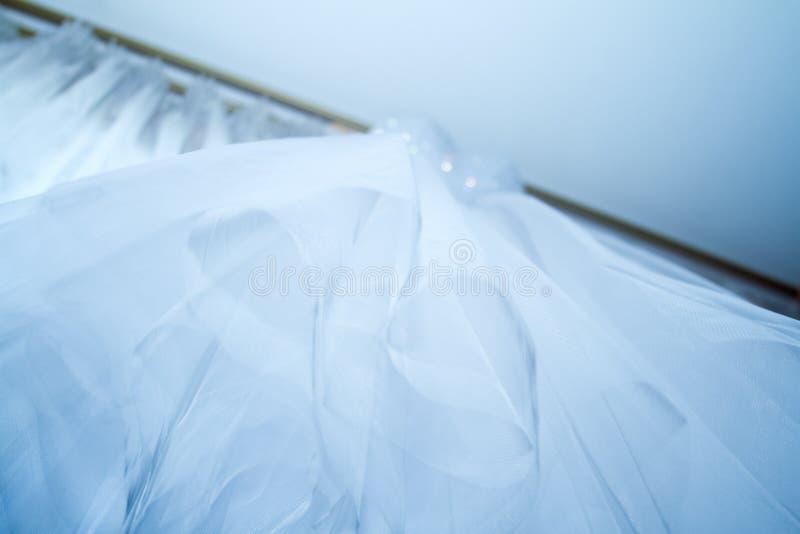 新娘礼服织品的细节和美好的刺绣婚礼概念或者背景 库存图片